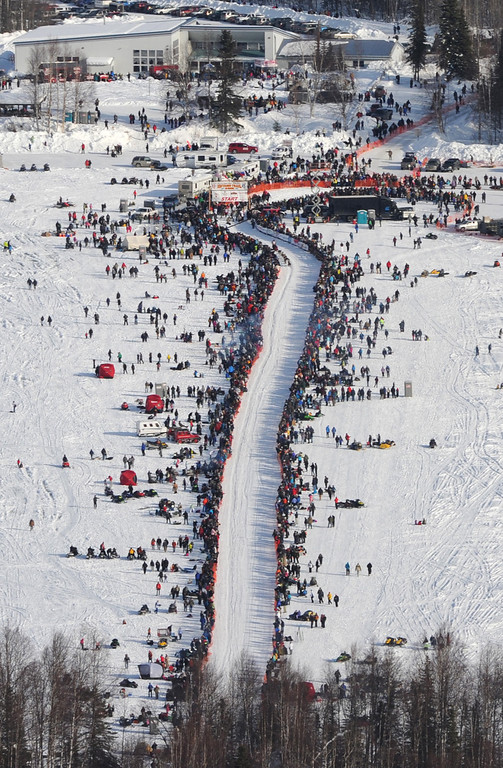 . A musher drives they dog team down the start chute across Willow Lake during the Iditarod Restart in Alaska, Sunday, March 3, 2013. Sixty-five mushers hit the Iditarod Trail on a 1,000 mile journey across the Alaska wilderness to the race finish in Nome. (Bill Roth/Anchorage Daily News/MCT)