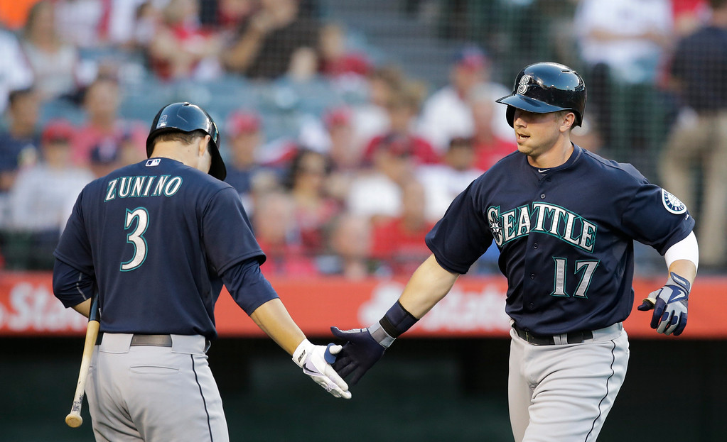 . Seattle Mariners\' Justin Smoak, right, celebrates his home run with Mike Zunino during the second inning of a baseball game against the Los Angeles Angels in Anaheim, Calif., Tuesday, June 18, 2013. (AP Photo/Jae C. Hong)