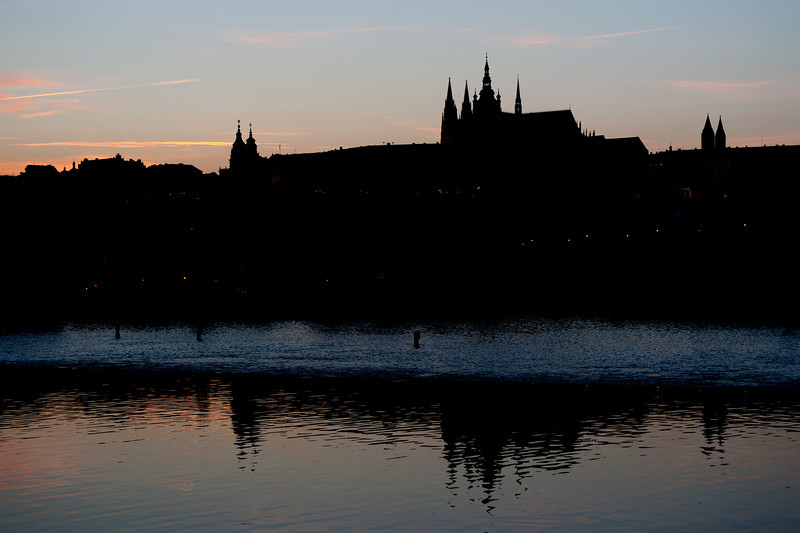 Structures and buildings reflected on water at dusk - Prague, Czech Republic