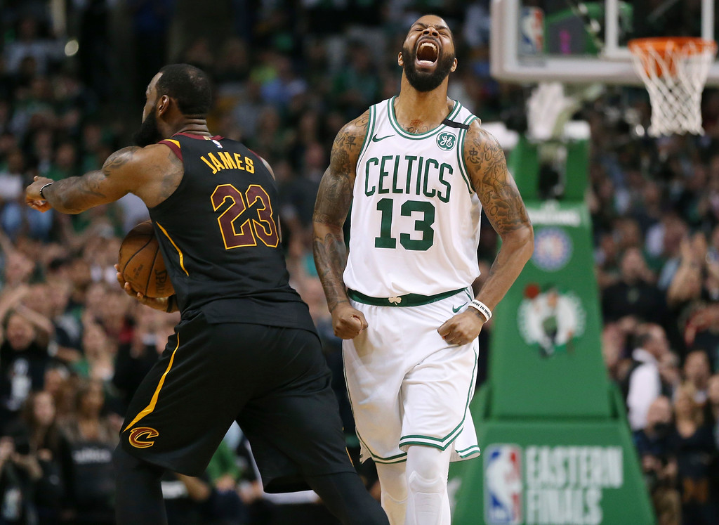 . Boston Celtics forward Marcus Morris, right, and Cleveland Cavaliers forward LeBron James react after James didn\'t cross the half court line in the allotted time during the second half in Game 7 of the NBA basketball Eastern Conference finals, Sunday, May 27, 2018, in Boston. (AP Photo/Elise Amendola)