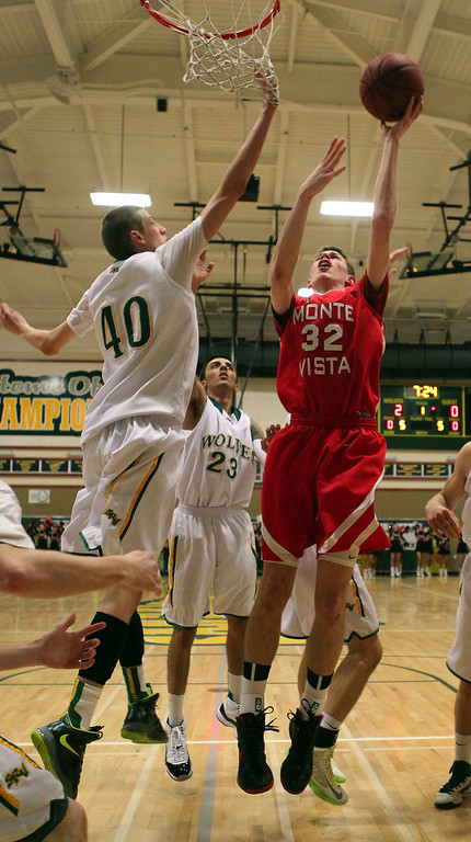 . Monte Vista\'s Spencer Rust (32) shoots the ball against San Ramon Valley\'s David Gunn (40) in the first half of their varsity boys basketball game in Danville, Calif., on Friday, Feb. 15, 2013. (Anda Chu/Staff)