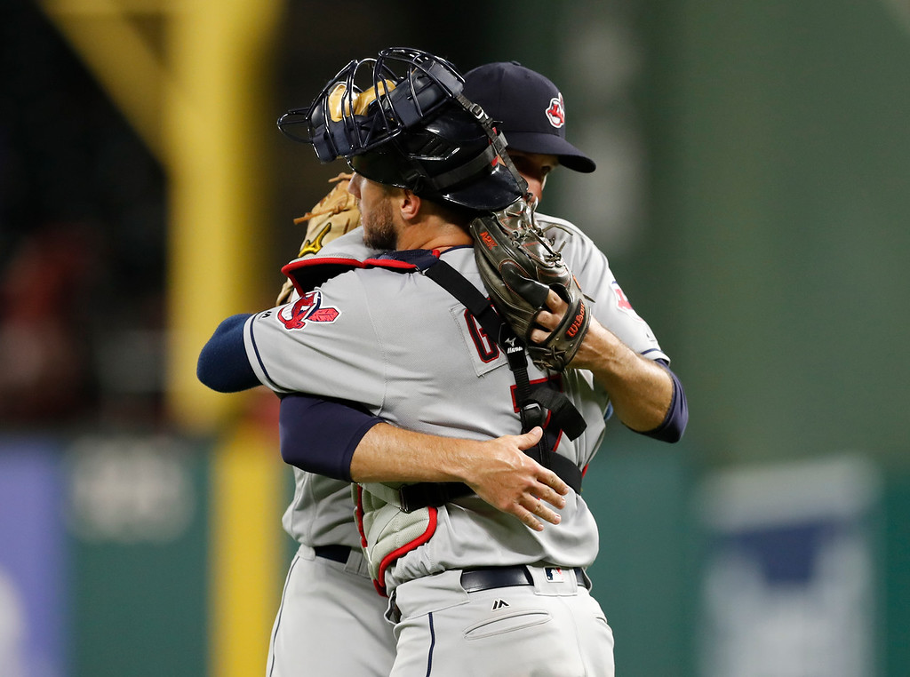 . Cleveland Indians catcher Yan Gomes (7) and relief pitcher Dan Otero embrace following the team\'s 9-8 win over the Texas Rangers in 11 innings in a baseball game, Friday, July 20, 2018, in Arlington, Texas. (AP Photo/Jim Cowsert)