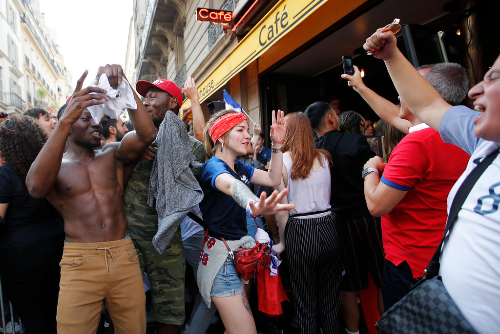 . French soccer team supporters dance in a street after won France won the soccer World Cup final match between France and Croatia, Sunday, July 15, 2018 in a cafe in Paris. France won its second World Cup title by beating Croatia 4-2 . (AP Photo/Francois Mori)