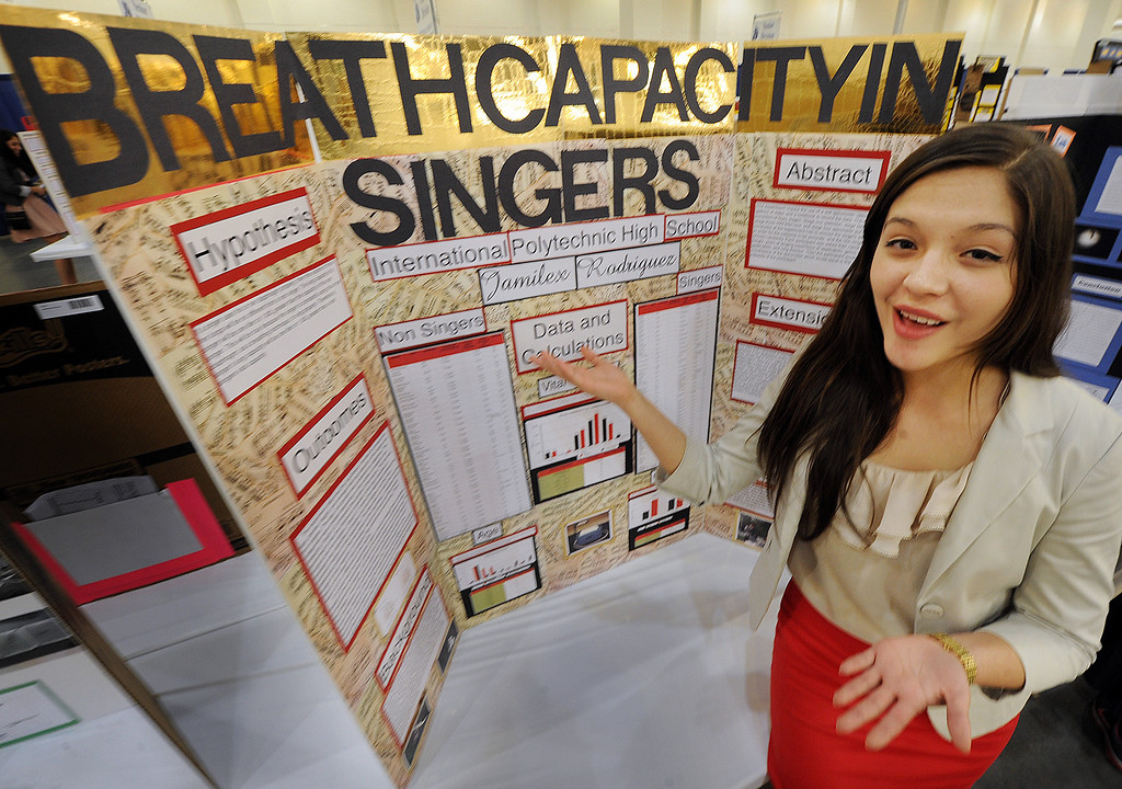 ". Jamilex, Rodriguez of West Covina, attends International Polytechnic High School in Pomona, explaining her science project, ""Breath Capacity in Singers\"", at the 63rd annual Los Angeles County Science Fair at Pasadena Convention Center Friday, March 22, 2013. Organizers scrambled to raise enough funds this year, and almost had to do without tables and chairs until a $25,000 donation by Southern California Edison at the last minute. (SGVN/Photo by Walt Mancini/SXCity)"