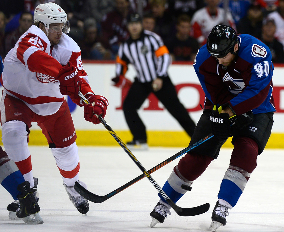 . DENVER, CO - February 5: Colorado Avalanche center Ryan O\'Reilly (90) watches as the puck heads back the ice while defending it from Detroit Red Wings defenseman Danny DeKeyser (65) during the first period Thursday, February 5, 2015 at the Pepsi Center in Denver, Colorado. (Photo By Brent Lewis/The Denver Post)