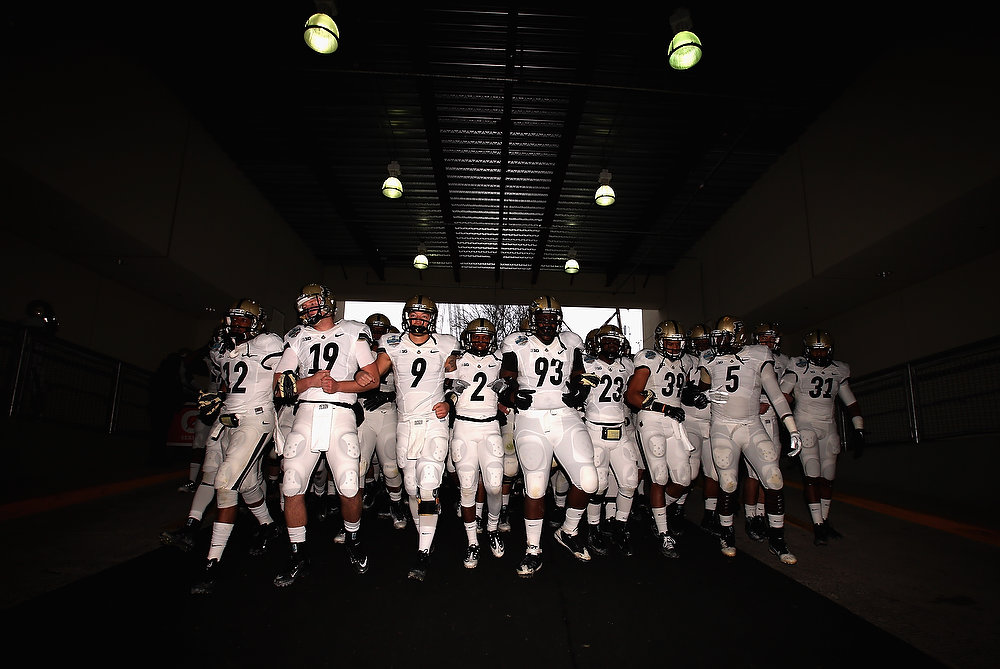 . The Purdue Boilermakers walk to the field before play against the Oklahoma State Cowboys during the Heart of Dallas Bowl at Cotton Bowl on January 1, 2013 in Dallas, Texas.  (Photo by Ronald Martinez/Getty Images)