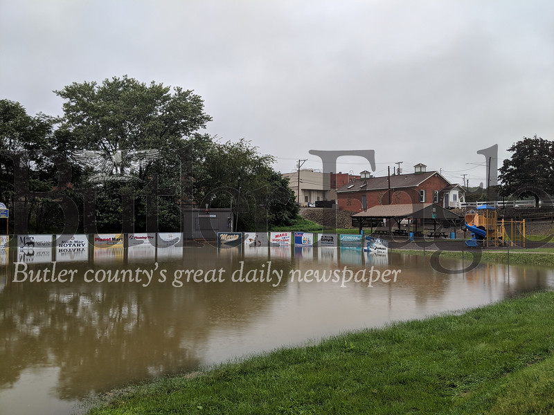 The softball field in Mars flooded overnight after Sunday's storm. (photos by Caleb Harshberger)
