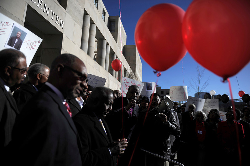 . Bishop Theodore Larry Kirkland (center) speaks to the crowd during a rally seeking justice for Marvin Lewis Booker, who was killed during an altercation with deputies while being booked on charges of possession of drug paraphernalia in 2010. Denver Detention Center on Wednesday, March 12, 2014. (Photo By AAron Ontiveroz/ The Denver Post)