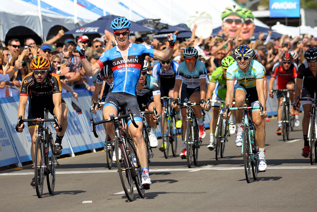 . Tyler Farrar, Garmin-Sharp, celebating his win after crossing the finish line of Stage 4 first. (Robert Torre/Special to the Sentinel)