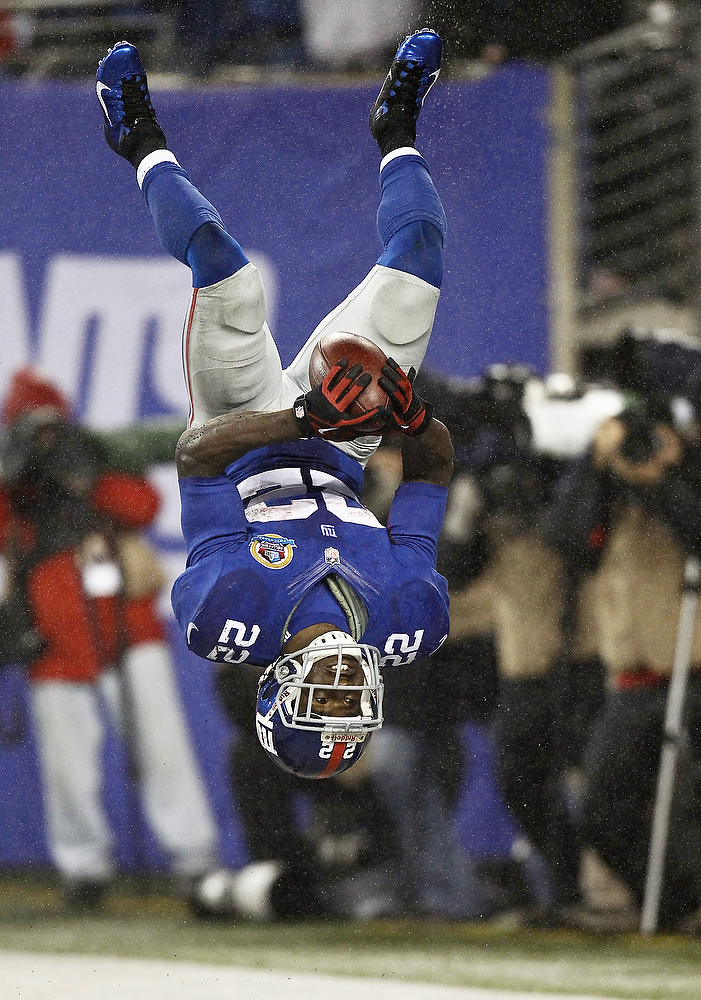 . David Wilson #22 of the New York Giants celebrates his third touchdown of a game against the New Orleans Saints at MetLife Stadium on December 9, 2012 in East Rutherford, New Jersey.  (Photo by Jeff Zelevansky/Getty Images)
