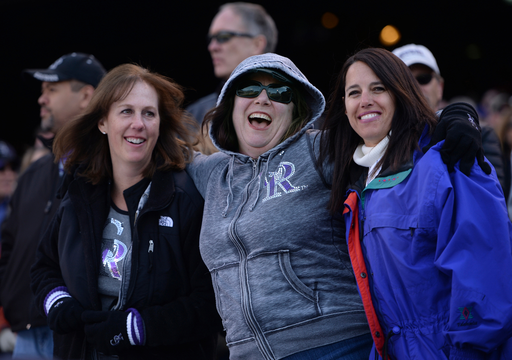 """. DENVER, CO - APRIL 4:  Friends Renee Vejvoda, left, Kimberly Orr, center, and Lisa Engbar, right, sang \""""Take Me Out to the Ballgame\"""" in the seventh inning stretch. The Colorado Rockies defeated the Arizona Diamondbacks 12-2 on opening day at Coors Field Friday afternoon, April 4, 2014 in Denver. (Photo by Karl Gehring/The Denver Post)"""