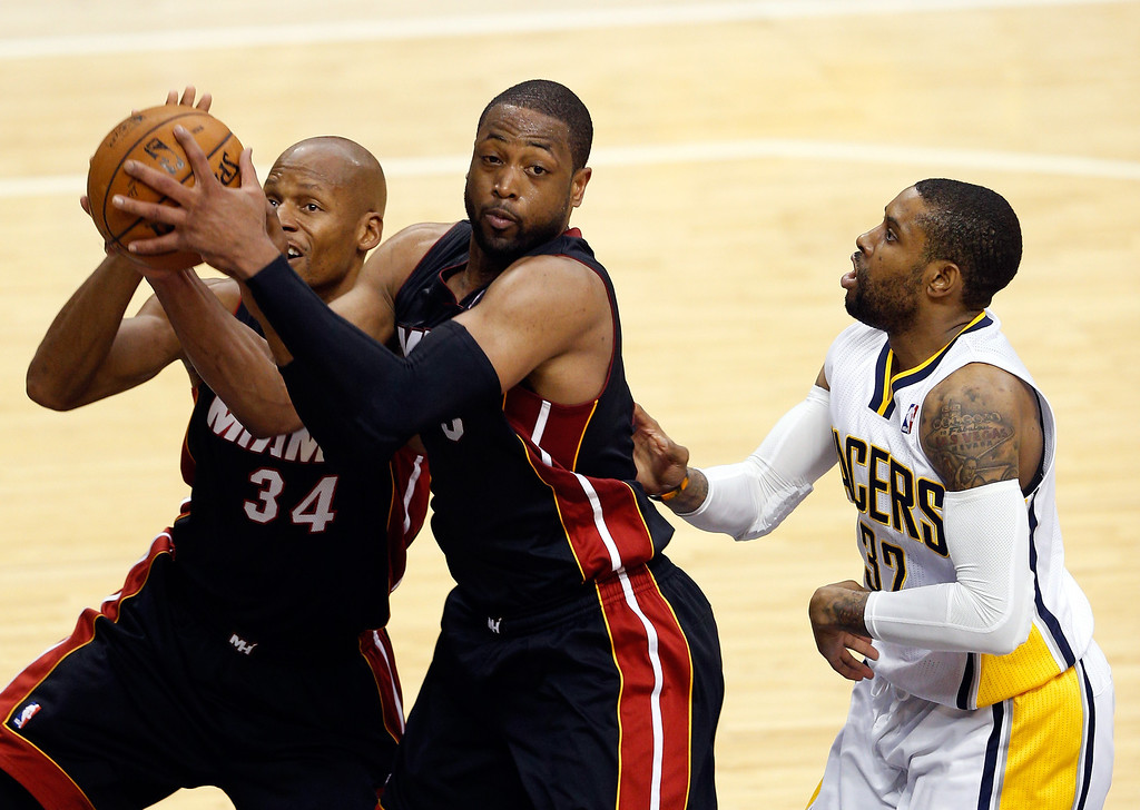 . INDIANAPOLIS, IN - MAY 28: Dwyane Wade #3 of the Miami Heat pulls down a rebound against the Indiana Pacers during Game Five of the Eastern Conference Finals of the 2014 NBA Playoffs at Bankers Life Fieldhouse on May 28, 2014 in Indianapolis, Indiana.  (Photo by Joe Robbins/Getty Images)