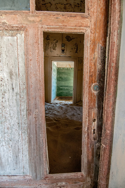 Looking through door of an abandoned building - Luderitz, Namibia