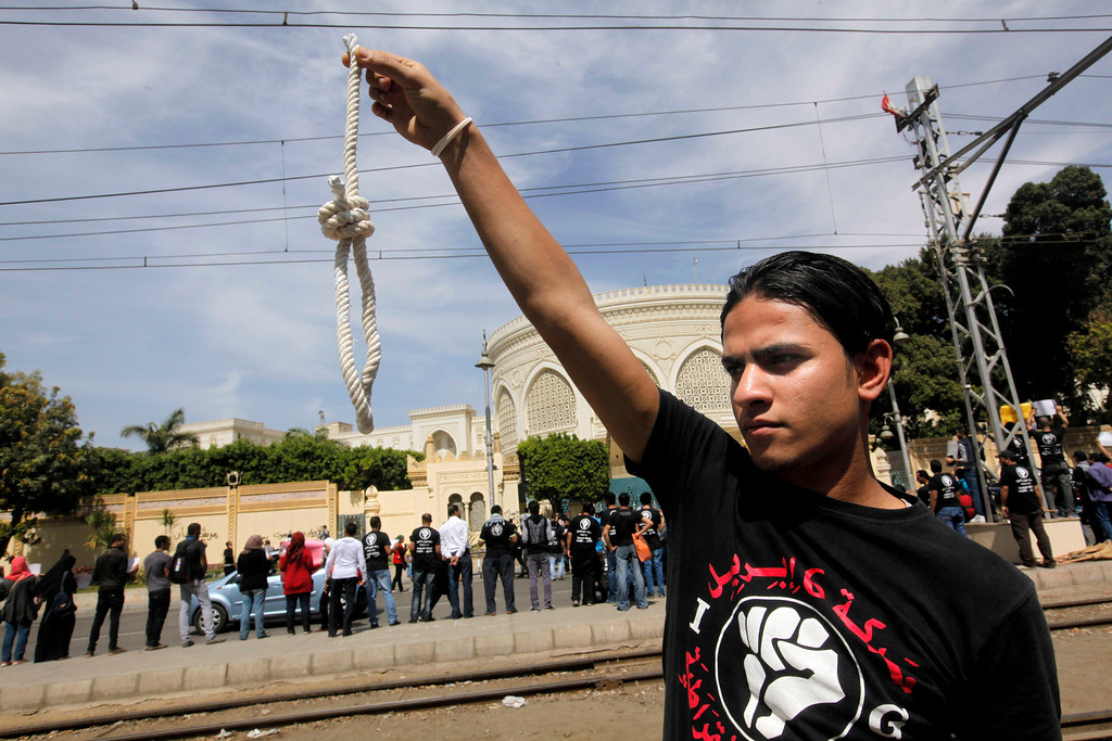 . A member of Egyptís April 6 Youth Movement holds a noose in front of the presidential palace in Cairo, Egypt, Saturday, April 6, 2013. The group is rallying to mark its fifth anniversary and to protest against President Mohammed Morsi. (AP Photo/Amr Nabil)