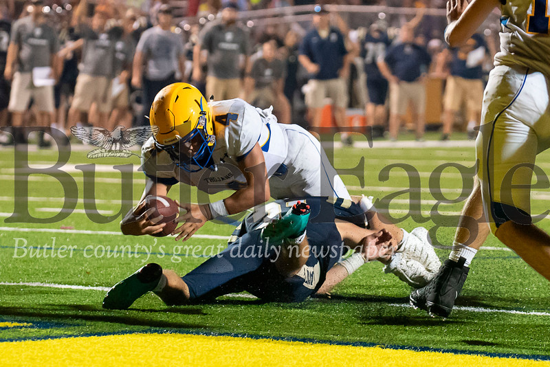 Derry's Onreey Stewart (4) dives into the end zone on 4th-and-goal during their overtime possession to put the Trojans up 19-13 over Freeport on Friday, Aug. 31, 2018 at Freeport Area Athletic Stadium.