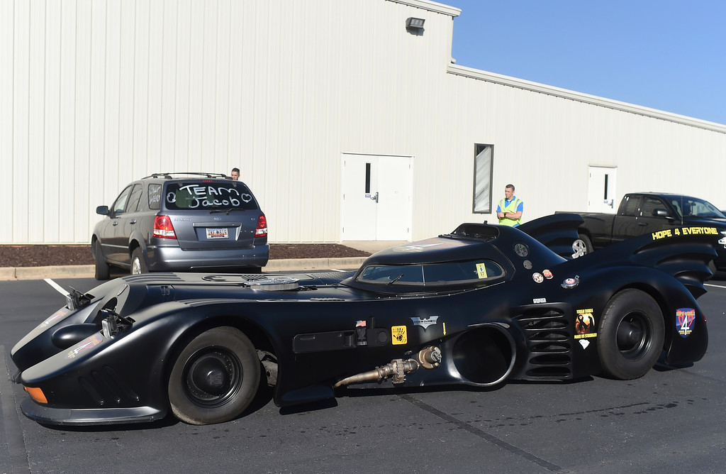 . A Batmobile arrives before a superhero-themed funeral service for Jacob Hall, a six-year-old boy who was killed in a school shooting, at Oakdale Baptist Church on Wednesday, Oct. 5, 2016, in Townville, S.C. Hall\'s family has encouraged people to dress as superheroes to celebrate what he enjoyed.  (AP Photo/Rainier Ehrhardt)