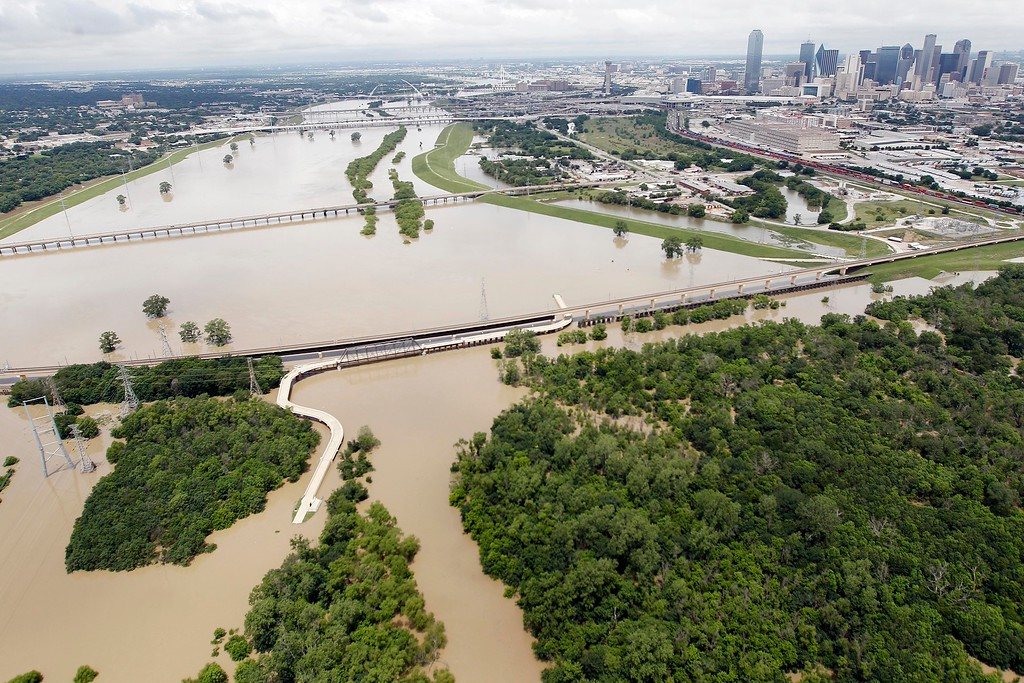 . A swollen Trinity River southwest of downtown Dallas, Friday, May 29, 2015. Floodwaters submerged Texas highways and threatened more homes Friday after another round of heavy rain added to the damage inflicted by storms. (AP Photo/Brandon Wade)