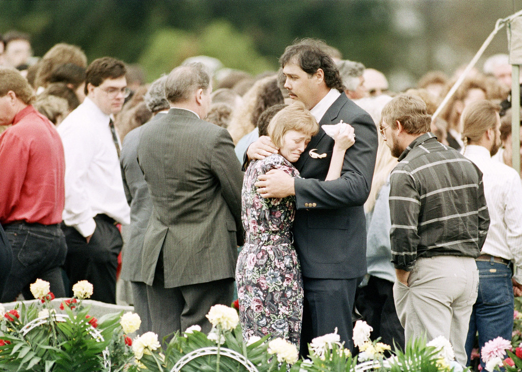 . Two mourners embrace at the funeral of prison guard Robert Vallandingham in Portsmouth, Ohio, April 19, 1993. Vallandingham was killed during a prison riot at the Southern Ohio Correctional Facility in Lucasville, Ohio. About 450 inmates have held a cellblock since April 11, when the rioting first broke out. (AP Photo/Al Behrman)