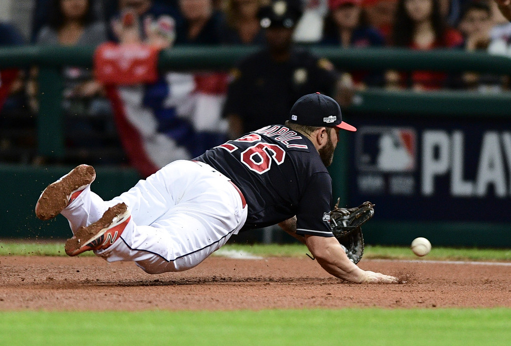 . Cleveland Indians first baseman Mike Napoli dives to stop a ground ball by Boston Red Sox\'s Hanley Ramirez during the ninth inning of Game 2 of a baseball American League Division Series, Friday, Oct. 7, 2016, in Cleveland. Ramirez was out at first. Cleveland won 6-0. (AP Photo/David Dermer)