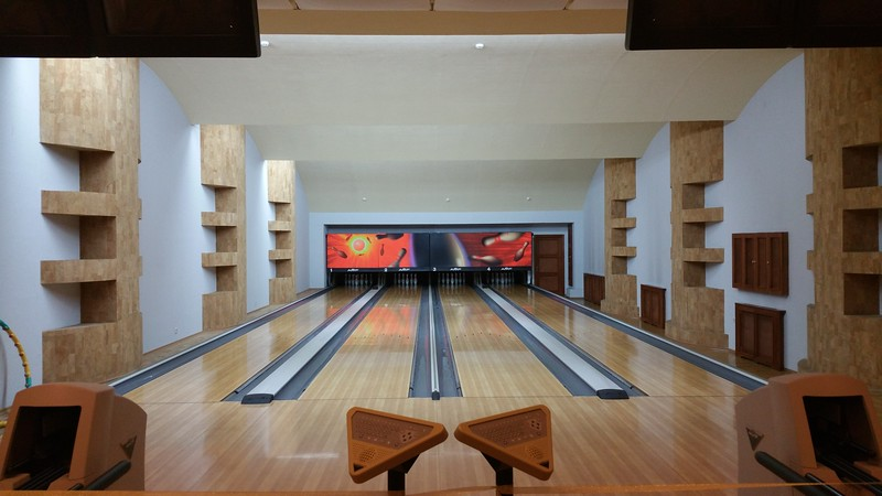 Our host allows inside and we put on shoe covers and behold this Bowling Alley...Wow!