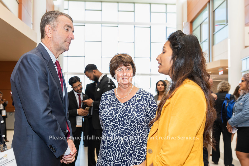 Governor Ralph Northam talks with Goerge Mason University President Anne Holton and senior Dolica Gopisety before an Amazon Web Services cloud computing degree launch event. Photo by Lathan Goumas/Office of Communications and Marketing   Photo Taken:Friday, September 20, 2019