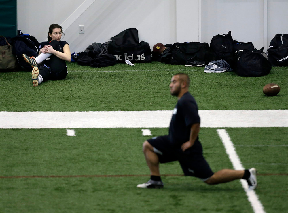 . Lauren Silberman, top left, warms up on the indoor turf before kicker tryouts at the NFL football regional combine workout on Sunday, March 3, 2013, in Florham Park, N.J. (AP Photo/Mel Evans)