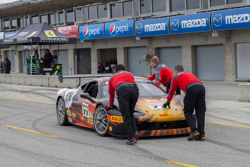 Crew taking care of the #77 Ferrari 458. © 2014 Victor Varela