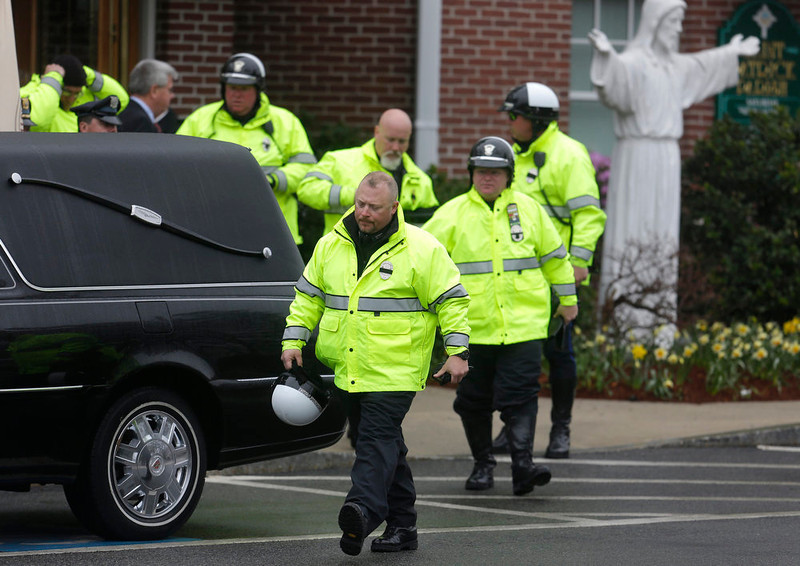 . Law enforcement officials depart St. Patrick\'s Church in Stoneham, Mass., following a funeral Mass for Massachusetts Institute of Technology police officer Sean Collier, Tuesday, April 23, 2013. Collier was fatally shot on the MIT campus Thursday, April 18, 2013. Authorities allege that the Boston Marathon bombing suspects were responsible. (AP Photo/Steven Senne)