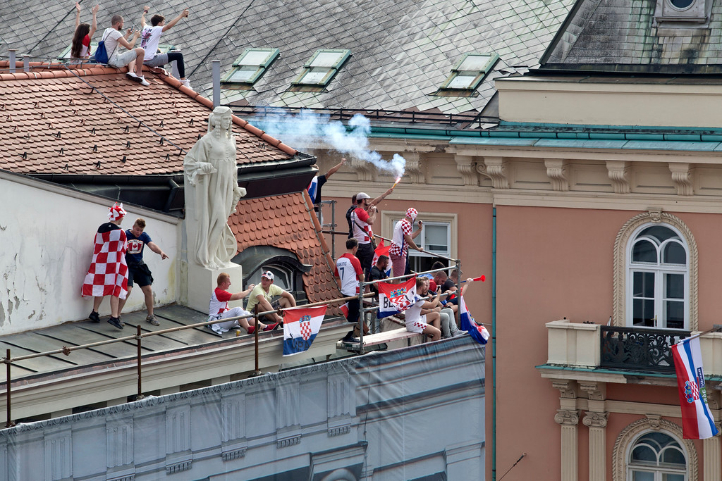. Supporters of the Croatian national soccer team cheer their team on as they watch the World Cup final game on a screen in central Zagreb, Croatia, Sunday, July 15, 2018. Croatia\'s national soccer team lost to France in the World Cup final in Russia. (AP Photo/Marko Drobnjakovic)