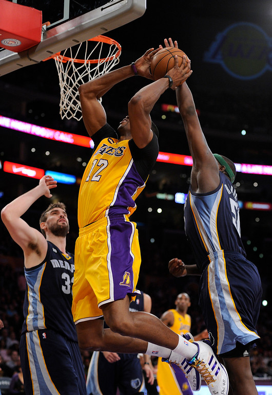 . The Lakers\' Dwight Howard has his shot blocked by the Grizzlies\' Zach Randolph in the first half, Friday, April 5, 2013, at Staples Center. (Michael Owen Baker/L.A. Daily News)