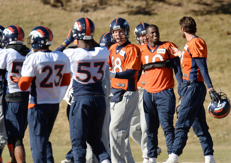 . Denver Broncos QB Peyton Manning (18) and the teammates huddle for the team practice at Dove Valley. Centennial Colorado. January 17. 2014. (Photo by Hyoung Chang/The Denver Post)