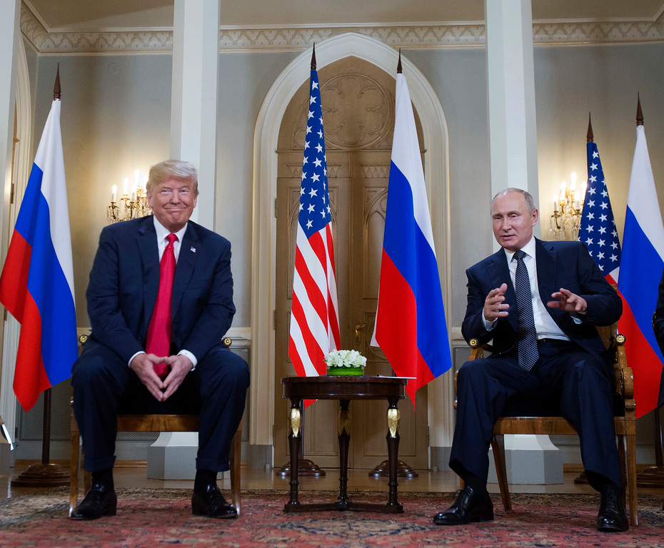 . Russian President Vladimir Putin, right, makes a statement as U.S. President Donald Trump, left, looks on at the beginning of a meeting at the Presidential Palace in Helsinki, Finland, Monday, July 16, 2018. (AP Photo/Pablo Martinez Monsivais)