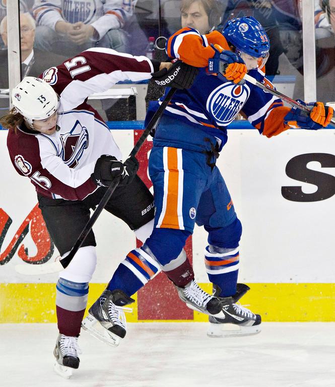 . Colorado Avalanche\'s PA Parenteau (15) checks Edmonton Oilers\' Ryan Nugent-Hopkins during the first period of their NHL hockey game, Monday, Jan. 28, 2013, in Edmonton, Alberta. (AP Photo/The Canadian Press, Jason Franson)