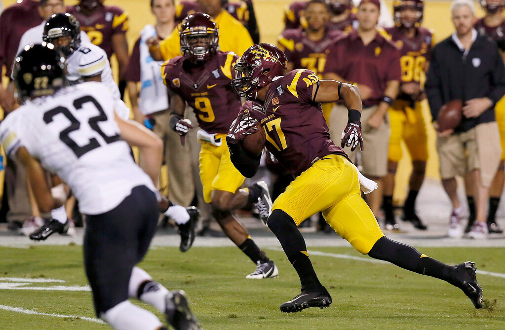 . Arizona State\'s Lloyd Carrington (17) runs with the ball after making an interception as Colorado\'s Nelson Spruce (22) and Paul Richardson (6) gives chase and Arizona State\'s Robert Nelson (9) looks on during the first half of an NCAA college football game on Saturday Oct. 12, 2013, in Tempe, Ariz. (AP Photo/Ross D. Franklin)