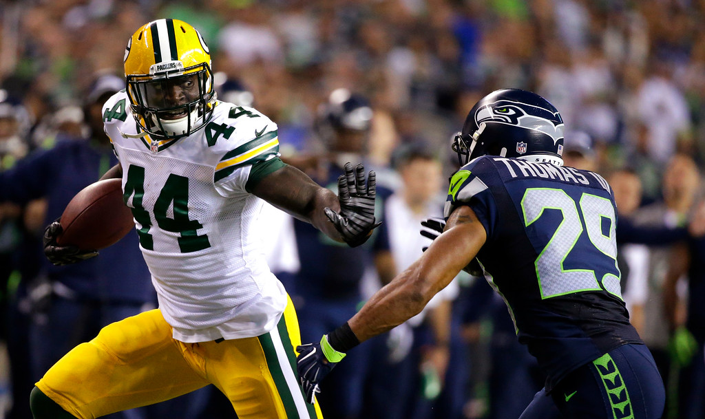 . Green Bay Packers running back James Starks (44) tries to hold off the defense of Seattle Seahawks free safety Earl Thomas during the second half of an NFL football game, Thursday, Sept. 4, 2014, in Seattle. (AP Photo/Elaine Thompson)
