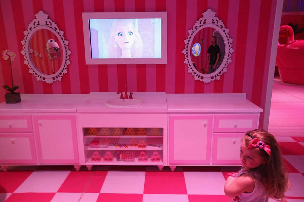 . Selina, 3, visits Barbie\'s bathroom at the Barbie Dreamhouse Experience on May 16, 2013 in Berlin, Germany. The Barbie Dreamhouse is a life-sized house full of Barbie fashion, furniture and accessories and will be open to the public until August 25 before it moves on to other cities in Europe.  (Photo by Sean Gallup/Getty Images)