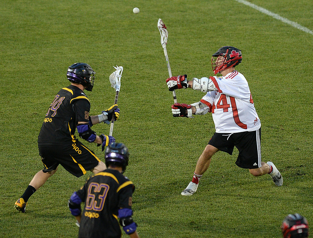 . COMMERCE CITY, CO - JULY 17: Canada midfielder Jordan Hall (44) worked the ball around in the first half.  The Iroquois Nationals took on Canada in a FIL World Championship semifinal game Thursday night, July 17, 2014.  Photo by Karl Gehring/The Denver Post