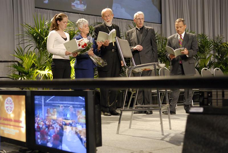 Elizabeth, Ione, Mark Hanson, Lowell Almen, and Carlos Peña sing in celebration after re-election of Presiding Bishop Mark Hanson.