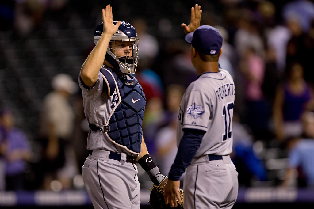 . DENVER, CO - AUGUST 13:  Nick Hundley #4 and Dave Roberts #10 of the San Diego Padres celebrate their 7-5 victory against the Colorado Rockies at Coors Field on August 13, 2013 in Denver, Colorado.  (Photo by Justin Edmonds/Getty Images)