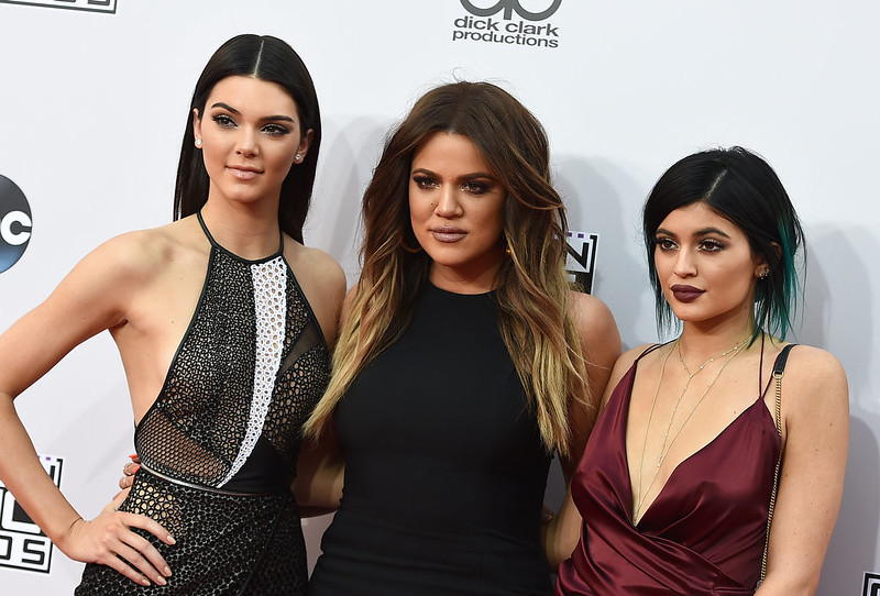 . Kendall Jenner, from left, Khloe Kardashian and Kylie Jenner arrive at the 42nd annual American Music Awards at Nokia Theatre L.A. Live on Sunday, Nov. 23, 2014, in Los Angeles. (Photo by Jordan Strauss/Invision/AP)