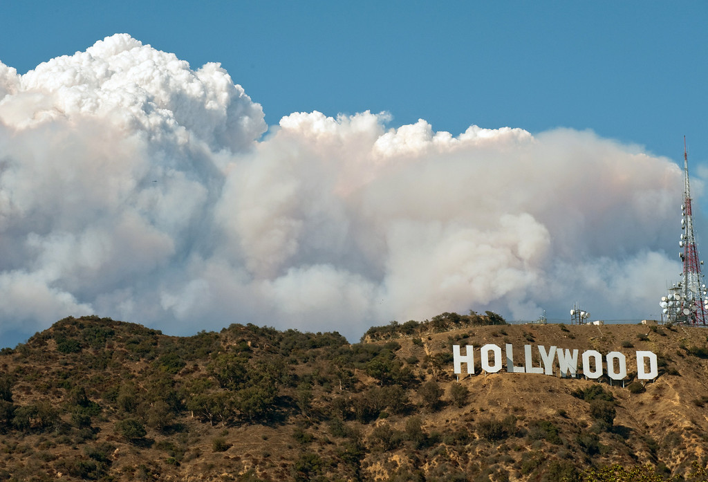. In this Saturday August 29,2009 photo showing smoke from the Station Fire billowing up from behind the famous Hollywood sign in the Hollywood Hill in Los Angeles.  (AP Photo/Anthony Citrano)