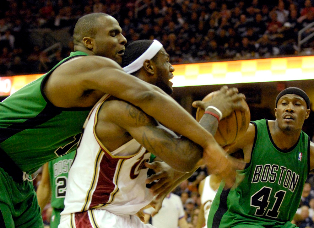 Description of . LeBron James is fouled by Celtics Glen Davis in the second half of Game 4 of the Eastern Conference Championships.