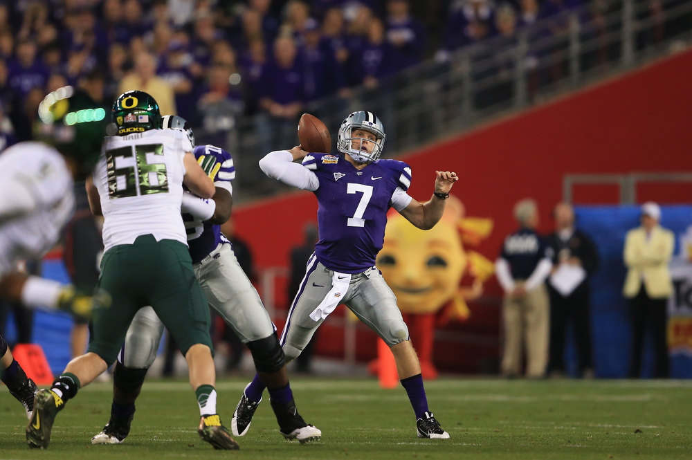 Description of . Collin Klein #7 of the Kansas State Wildcats looks to pass in the first quarter against the Oregon Ducks during the Tostitos Fiesta Bowl at University of Phoenix Stadium on January 3, 2013 in Glendale, Arizona.  (Photo by Doug Pensinger/Getty Images)