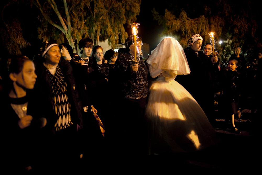 Description of . An Ultra-Orthodox Jewish bride arrives for her wedding ceremony, which was attended by thousands of people, in Netanya, Israel, Wednesday, Jan. 2, 2013. (AP Photo/Oded Balilty)