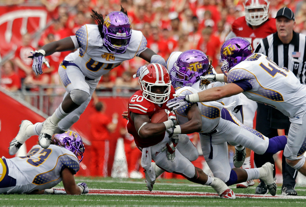 . Wisconsin\'s James White runs during the second half of an NCAA college football game against Tennessee Tech Saturday, Sept. 7, 2013, in Madison, Wis. Wisconsin won 48-0. (AP Photo/Morry Gash)