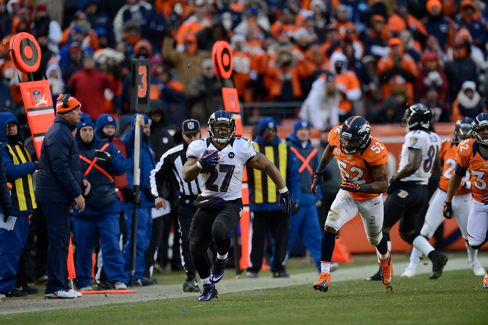 Description of . Baltimore Ravens running back Ray Rice (27) makes a run in the third quarter before being pushed out of bounds. The Denver Broncos vs Baltimore Ravens AFC Divisional playoff game at Sports Authority Field Saturday January 12, 2013. (Photo by Joe Amon,/The Denver Post)