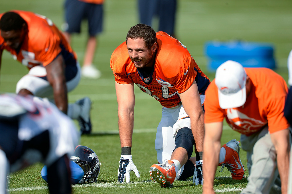 . Denver Broncos tight end Jacob Tamme (84) stretches on day five of the Denver Broncos 2014 training camp July 28, 2014 at Dove Valley. (Photo by John Leyba/The Denver Post)