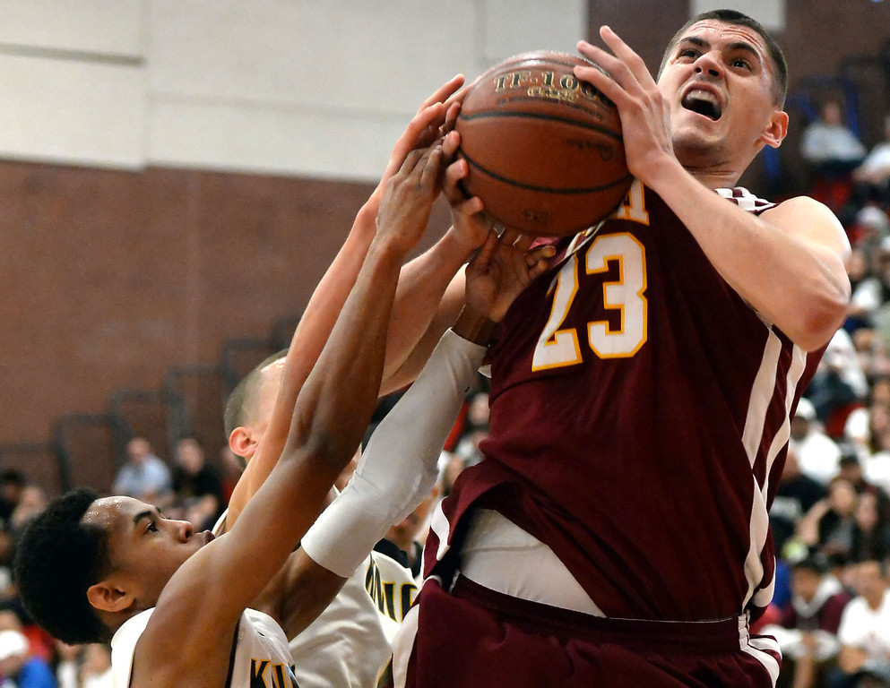 . Cantwell\'s Gligorije Rakocevic (23) fights for the rebound against Bishop Montgomery in the first half of a CIF Southern California Regional Division IV basketball game at Colony High School in Ontario, Calif., on Saturday, March 22, 2014.  (Keith Birmingham Pasadena Star-News)
