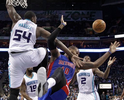 . Detroit Pistons\' Greg Monroe (10) is fouled by Charlotte Hornets\' Jason Maxiell (54) during the first half of an NBA basketball game in Charlotte, N.C., Tuesday, Feb. 10, 2015. (AP Photo/Chuck Burton)