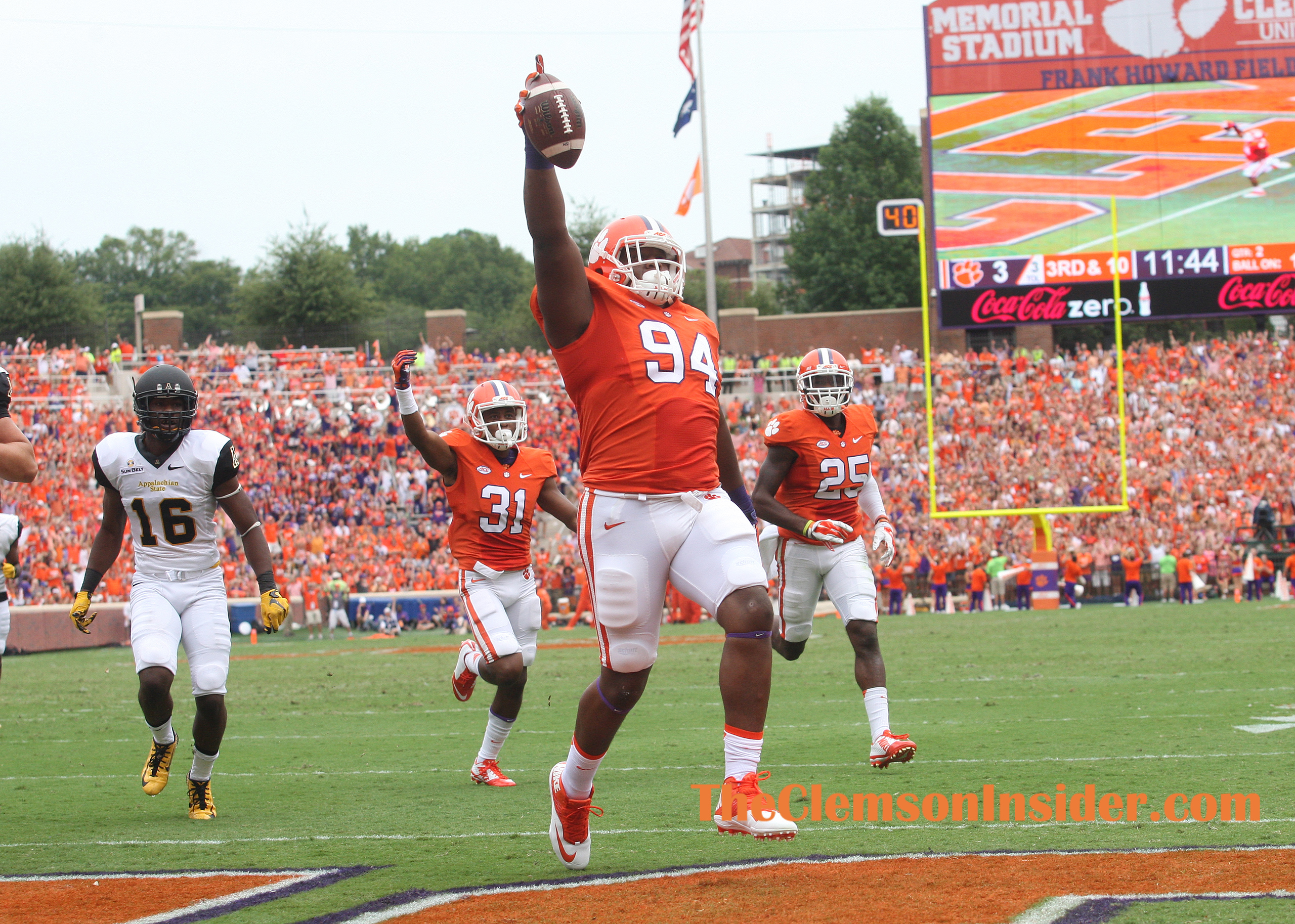 Clemson defensive tackle Carlos Watkins (94) returns an interception against Appalachian State for a touchdown during the 2nd quarter Saturday, September 12, 2015 at Clemson's Memorial Stadium.